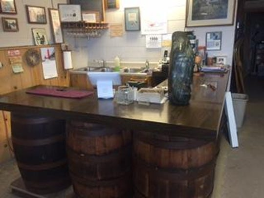 The tasting room bar can accommodate just eight customers.