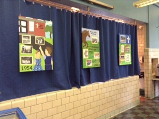 Canvas paintings, depicting St. Mary's Prep through the years, were displayed in the cafeteria during an alumni breakfast.