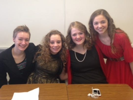 Senior Cecily Vandenhouten, sophomores Macrina Schry and Emily Dolan, and freshman Samantha Boehm prepare for their individual performances in the Solo and Ensemble Festival at Lourdes.