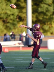 Arlington's Austin Heck passes the ball during a Sept.
