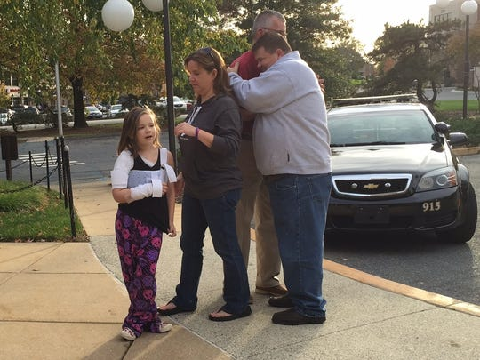 Emily Ruckle arrives at the Newark police station with
