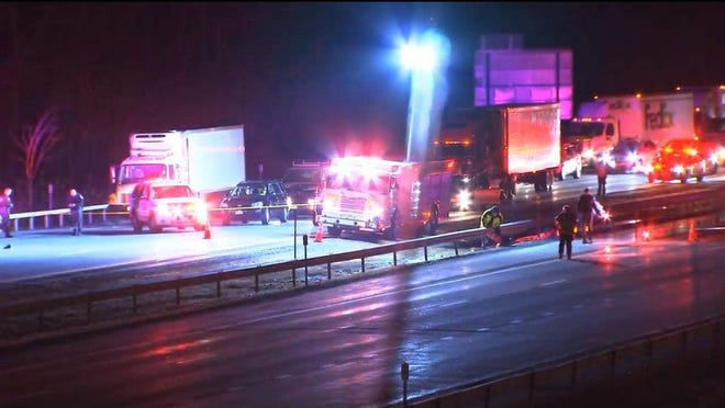 Police investigate the scene early Sunday morning where a New Windsor man was fatally struck on the Thruway in the Town of Newburgh.
