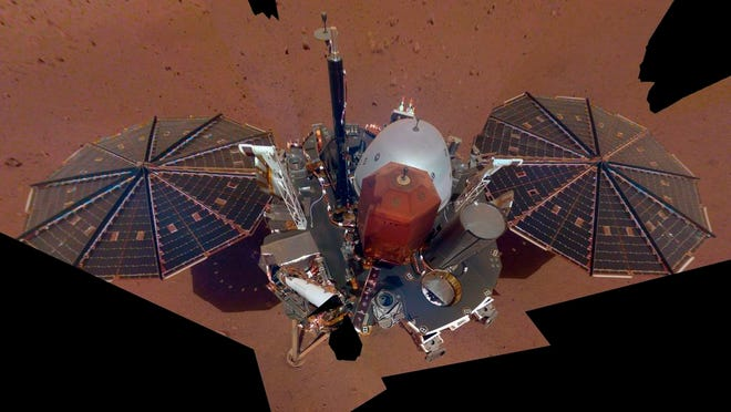 FILE - This Dec. 6, 2018 image made available by NASA shows the InSight lander. The scene was assembled from 11 photos taken using its robotic arm. On Thursday, Jan. 14, 2021, NASA declared the craft dead after failing to burrow deep into the red planet to take its temperature.