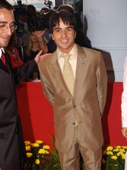 Four years into his recording career, Luis Fonsi attends
