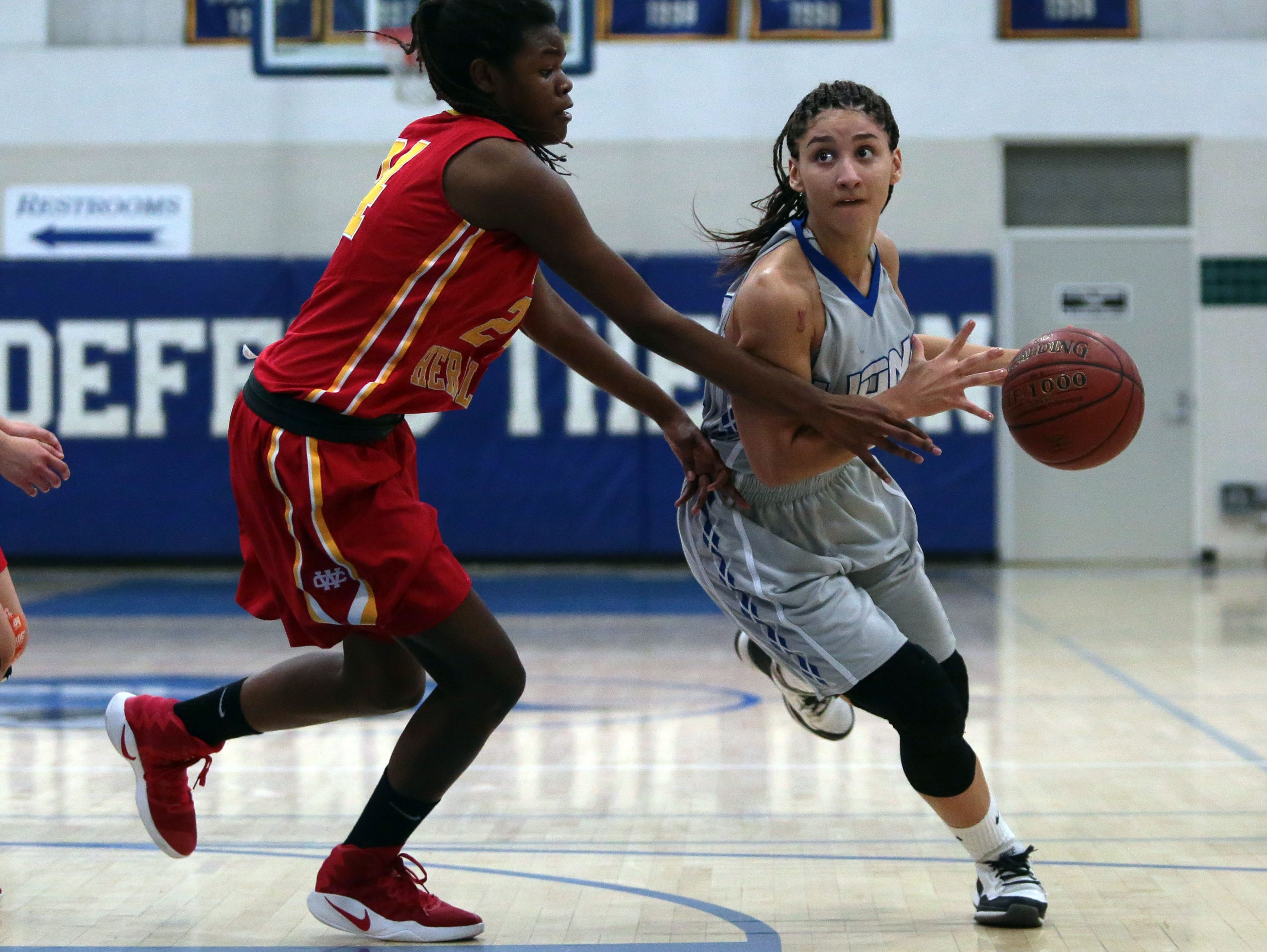 Cathedral City's Le'Anna Broom moves pass Whittier Christian defenders on Saturday, February 18, 2017 in Cathedral City.
