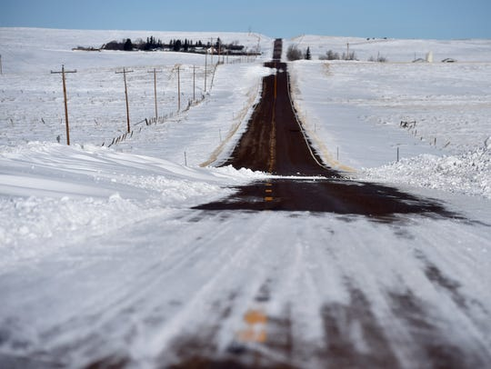 Snow drifts across the Santa Rita Highway north of
