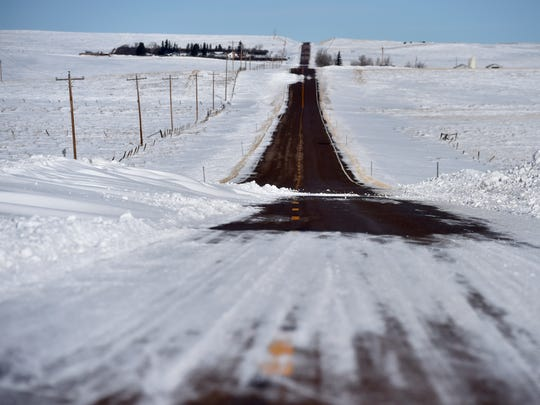 Snow drifts across the Santa Rita Highway north of