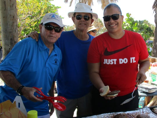 Carlos Mejía, left, Dan Carroll and Ariana Guadalupe at Jensen Beach Park for the Spanish American Club's annual picnic.