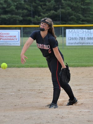 Marshall pitcher Brenna Hayes throws home during district action vs. Pennfield on Saturday.