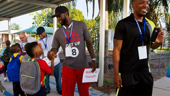 From right, Dwayne Jackson and Emmitt Williams were some of the community volunteers in hand at Franklin Park Elementary Monday morning greeting students back on the first day of school. The greeters have been a tradition at the school for several years.