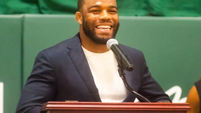 Jordan Burroughs speaks during the dedication ceremony for Jordan Burroughs Gymnasium at Winslow Township High School on Saturday, September 24.