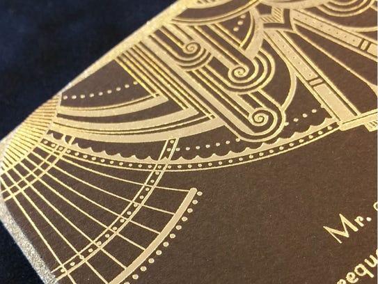 Metallic details on wedding invitations add drama.