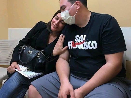 Chris Betancourt with his mother, Alex. She has dealt