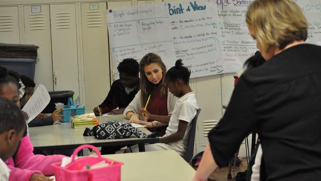 Louisiana State University education major Madeline Brown (left) teaches alongside D.F. Huddle teacher Stacey Holder (right).
