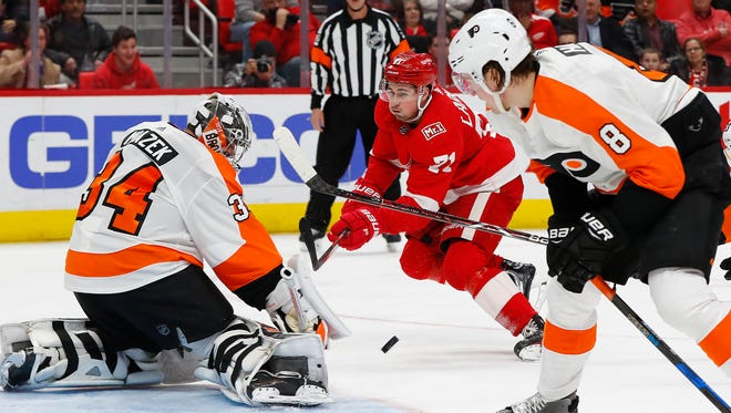 Dylan Larkin shoots on Flyers goaltender Petr Mrazek during the second period Tuesday at LCA.