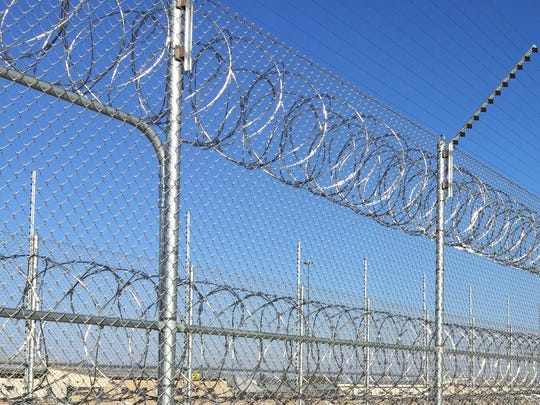 A prison fence at the Iowa State Penitentiary at Fort Madison. A similar fence surrounds the medium-security Newton Correctional Facility.