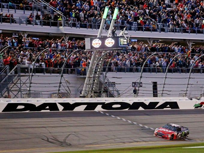 Kurt Busch crosses the finish line to win the Daytona