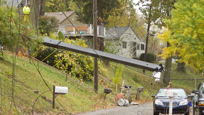 A tipped crane snagged numerous utility lines on Sunrise Park Drive near Lake Chemung in Genoa Township Monday, Oct. 23, 2017. It also damaged a house.