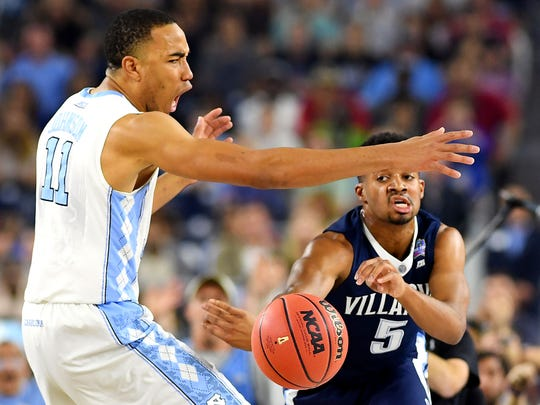 Apr 4, 2016; Houston, TX, USA; Villanova Wildcats guard Phil Booth (5) passes the ball against North Carolina Tar Heels forward Brice Johnson (11) during the first half in the championship game of the 2016 NCAA Men's Final Four at NRG Stadium.