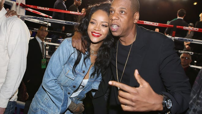 NEW YORK, NY - JANUARY 09:  Rihanna and Jay Z attend 2015 Throne Boxing Fight Night at The Theater at Madison Square Garden on January 9, 2015 in New York City.