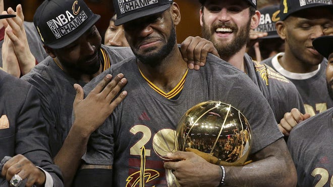 Cavaliers forward LeBron James, center, celebrates with teammates after Game 7 of basketball's NBA Finals against the Golden State Warriors on June 19, 2016.