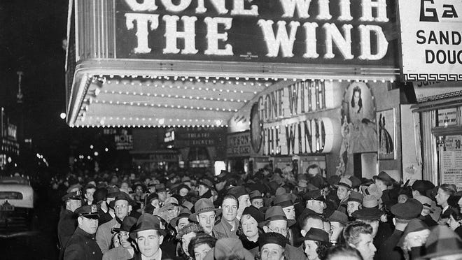 """In this Dec. 19, 1939 file photo, a crowd gathers outside the Astor Theater on Broadway during the premiere of """"Gone With the Wind"""" in New York. HBO Max has temporarily removed """"Gone With the Wind"""" from its streaming library in order to add historical context to the 1939 film long criticized for romanticizing slavery and the Civil War-era South."""