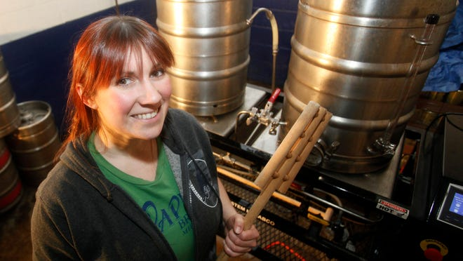 Brewmaster Ashley Kinart stands by a pilot system at Capital Brewery in Middleton. Over the past few years, there's been a slow-but-steady increase in the number of women working in craft brewing in Wisconsin. And the number of women drinking beer has increased, too.