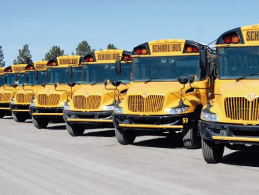 Sun-News file photo/Robin Zielinski   School buses are lined up in parking lot off of North 17th Street.