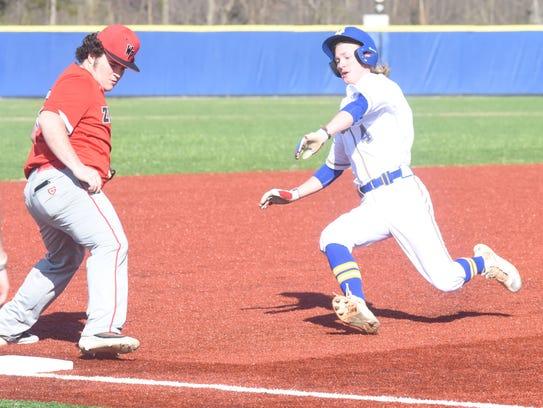 Mountain Home's Gage McClain slides into third base