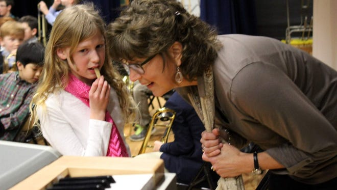 Meredith Loomis gets some last-minute pointers from teacher Debbie Parker before the concert.