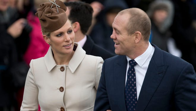 Queen's granddaughter Zara Phillips and husband, rugby player Mike Tindall, at  Sandringham, in December 2012. She will be godparent to Prince George.