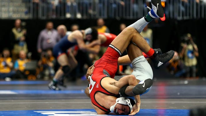 Rutgers' John Van Brill find himself in a tough position against North Carolina's Kennedy Monday during Thursday's pre-quarterfinal bout at NCAA National Championships. Van Brill recovered and won the bout, 10-7.