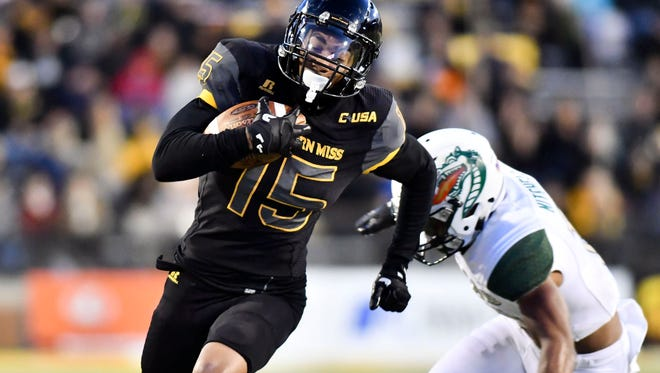 Oct 28, 2017; Hattiesburg, MS, USA; Southern Miss Golden Eagles wide receiver Allenzae Staggers (15) runs the ball against the UAB Blazers during the first quarter at M. M. Roberts Stadium. Mandatory Credit: Matt Bush-USA TODAY Sports