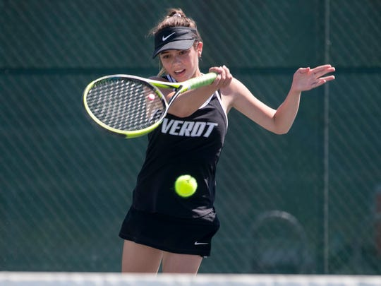 Marina Lombardo, of Bishop Verot High School, plays Rachel Weaver, of Cypress Lake High School, in the finals of the 2A-12 District Tennis Championships on Thursday at Three Oaks Community Park in Fort Myers.