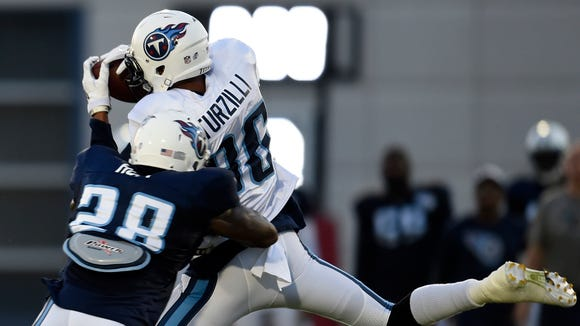 Titans wide receiver Andrew Turzilli (86) pulls in
