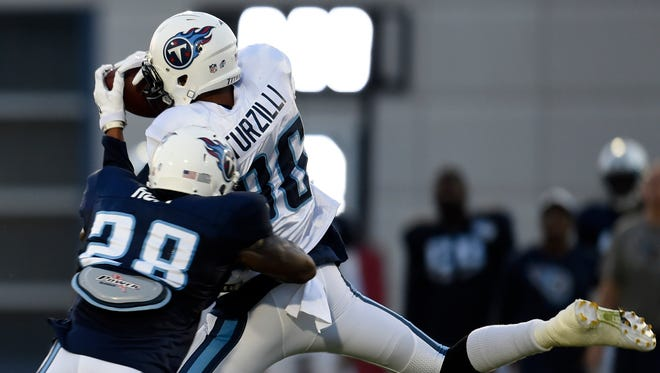 Titans wide receiver Andrew Turzilli (86) pulls in a pass over Titans defensive back Marqueston Huff (28) at Saint Thomas Sports Park during a preseason practice.