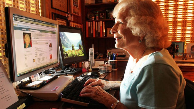 Rosie Chapman works on Facebook at her home in Orlando, Fla.
