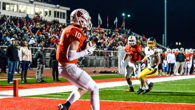 Colerain tight end Luke Ponting catches a touchdown pass against Moeller in their OHSAA Region 4 Playoff game at Cardinal Stadium, Friday, Nov. 3, 2017