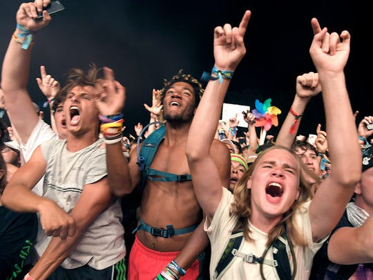 Fans cheer during Travis Scott's performance on the final night of the 2017 Bonnaroo Music and Arts Festival.