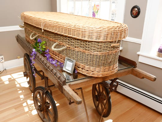 A hand made wicker casket at Dying to Bloom, a natural