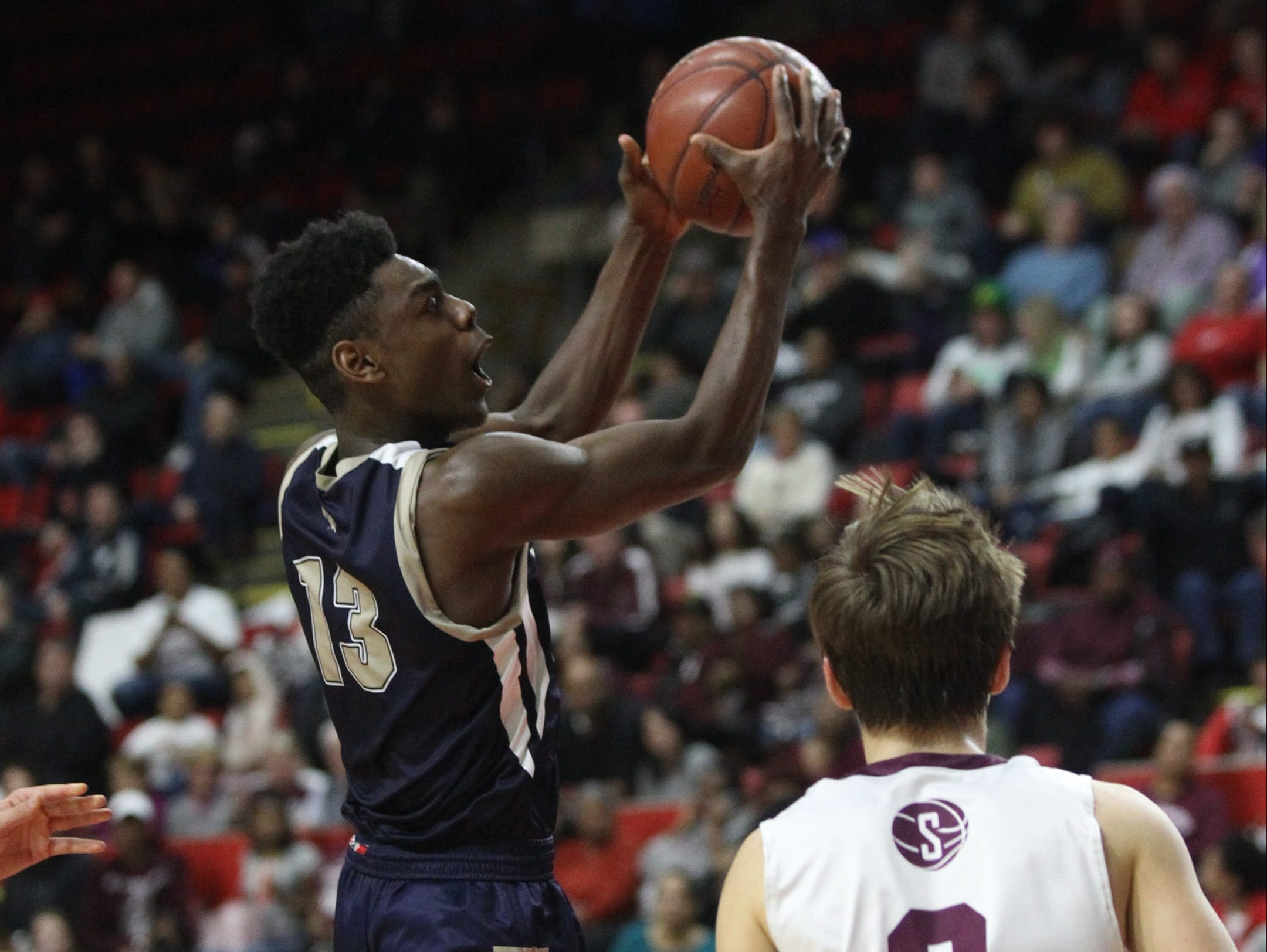 Our Lady of Lourdes's Kevin Townes (13) puts up a shot during their 70-67 win over Southampton in the NYSPHSAA boys Class A semifinal basketball game at Floyd L. Maines Veterans Memorial Arena in Binghamton on Saturday, March 18, 2017.