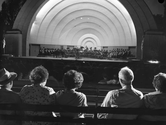 Concertgoers settle in to hear the AC Spark Plug Brass Band at the Blatz Temple of Music in Washington Park. This photo was published in the June 28, 1954, Milwaukee Journal.