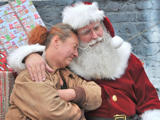 Santa consoles Nancy Reynolds during the Believe in