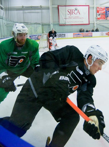 Flyers' Ivan Provorov, front, practices with the team Friday, Sept. 30 in Voorhees.