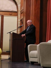Dr. Charles Murray waits to speak as Middlebury College