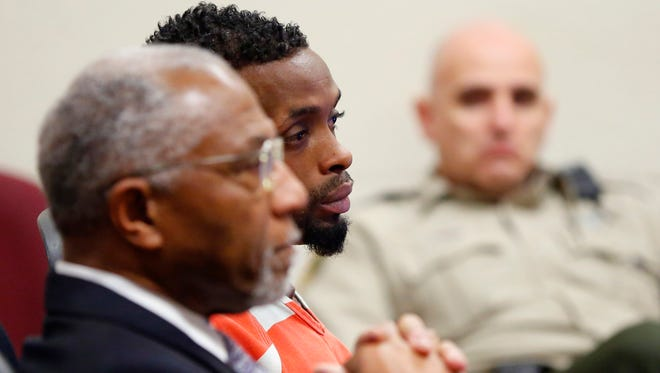 Dresean Barber with defense attorney Alfredo Parrish on Tuesday, Dec. 29, 2015.