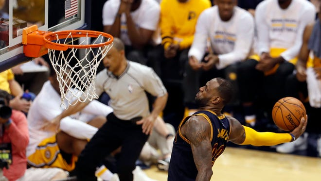 Apr 20, 2017; Indianapolis, IN, USA; Cleveland Cavaliers forward LeBron James (23) dunks against the Indiana Pacers in game three of the first round of the 2017 NBA Playoffs at Bankers Life Fieldhouse. Cleveland defeats Indiana 119-114.