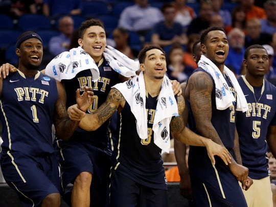 Pittsburgh players Jamel Artis (1), James Robinson (0), Cameron Wright (3), Michael Young (2) and Durand Johnson (5) cheer at the end of the second half in a second-round game in the NCAA college basketball tournament against Colorado, Thursday, March 20, 2014, in Orlando, Fla. Pittsburgh won 77-48. (AP Photo/John Raoux)