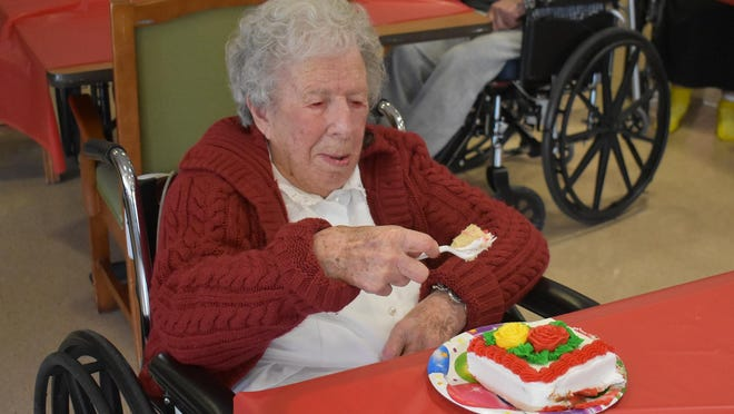Ruth Siddons Grant enjoys a piece of her birthday cake at the Sullivan County Adult Care Center in Liberty on Tuesday. Grant was celebrating turning 111.