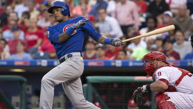 The Chicago Cubs' Addison Russell bats against the Philadelphia Phillies. The Cubs became the first team since the 1976 Cincinnati Reds to have five players voted as All-Star Game starters.